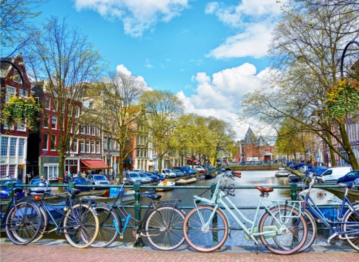 Five bicycles parked on a bridge in Amsterdam, The Netherlands. Image: MarinaDa/Shutterstock