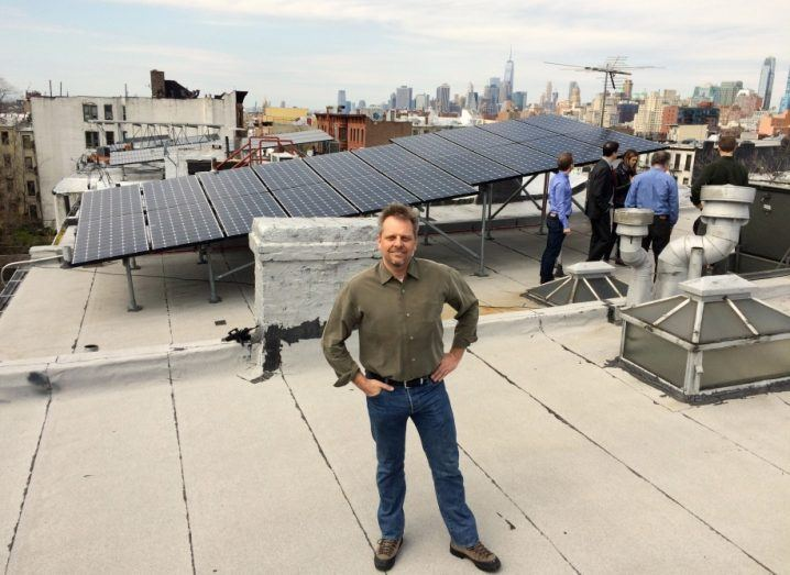 Lawrence Orsini, LO3 Energy, on the roof of a house connected to the Brookly Microgrid. Image: LO3 Energy