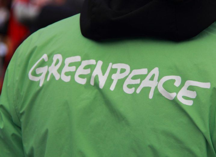 Greenpeace member wearing logo t-shirt
