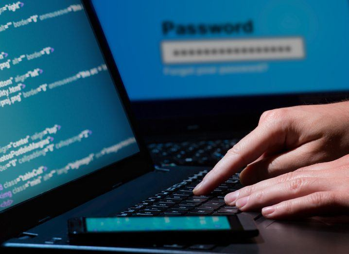hacker using laptop data breaches