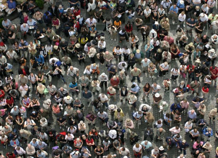 Crowd image by Olga Kolos via Shutterstock