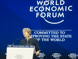 Theresa May singles out encrypted messaging apps in Davos address