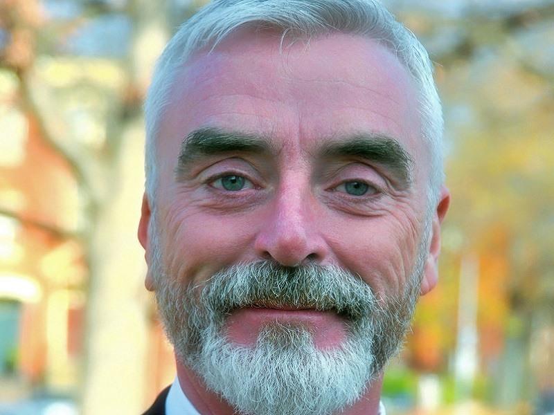 Headshot of Michael H Moloney smiling.