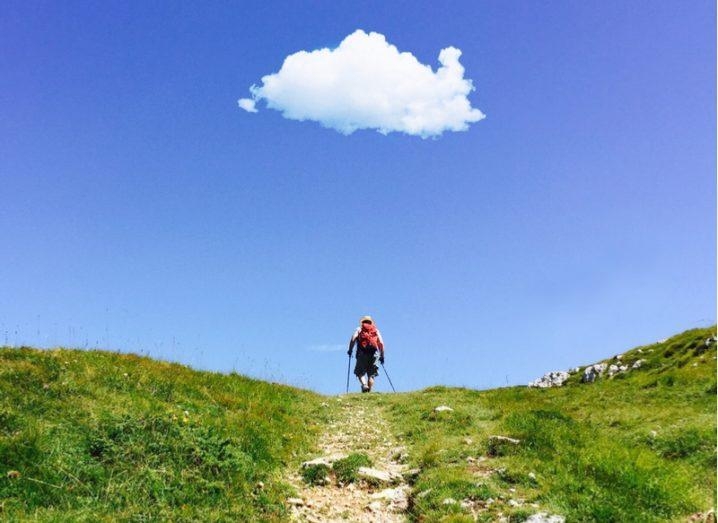 man hiking cloud computing