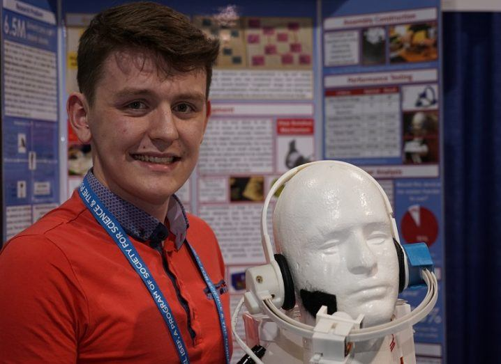 Aaron Hannon with his device at ISEF 2018