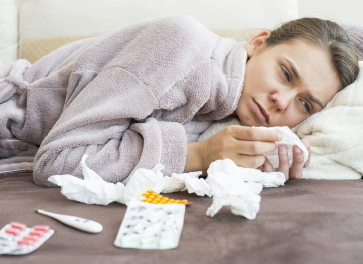 Person lying on the couch with the common cold