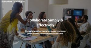 image of people collaborating around a screen in a meeting room