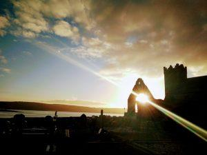 Golden sunrays coming through the monastery wall in Abbeyside, Dungarvan, co. Waterford, Ireland.