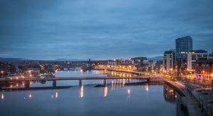View over river Shannon of hotels and buildings in Limerick