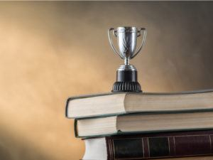 Trophy stacked on books