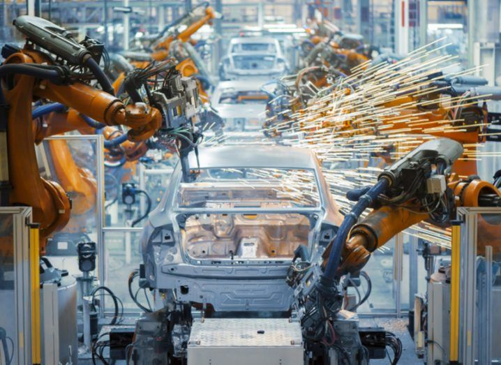 Robots working in a factory producing cars