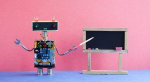 A toy robot pointing to a blackboard teaching you about AI.
