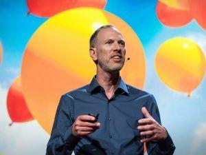 Tim Leberecht on backdrop of coloured balloons. Image: TEDx