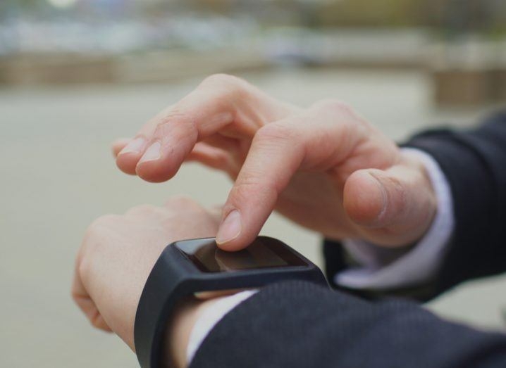 Person interacting with smartwatch
