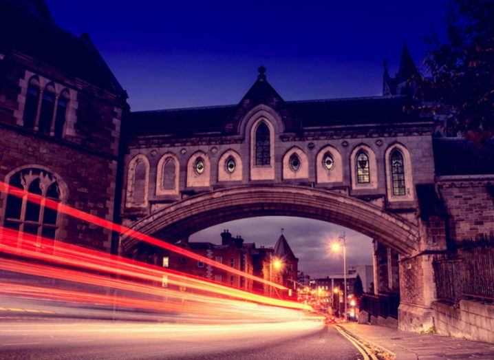 Traffic lights through the Arch of the Christ Church Cathedral in Dublin, Ireland at night
