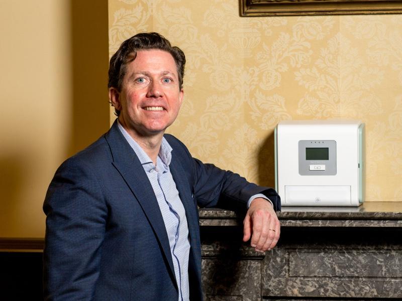 Jim Joyce standing beside medtech machine