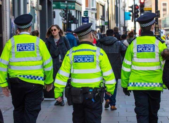 Three police officers on a London street