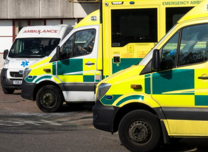 Three parked NHS ambulances in diminishing perspective.