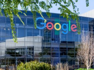 Google office building with logo on window in Mountain View headquarters