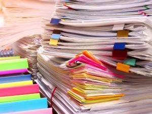 piles of files and notes, employee data