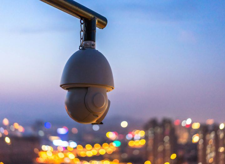 CCTV camera at night with city lights in background