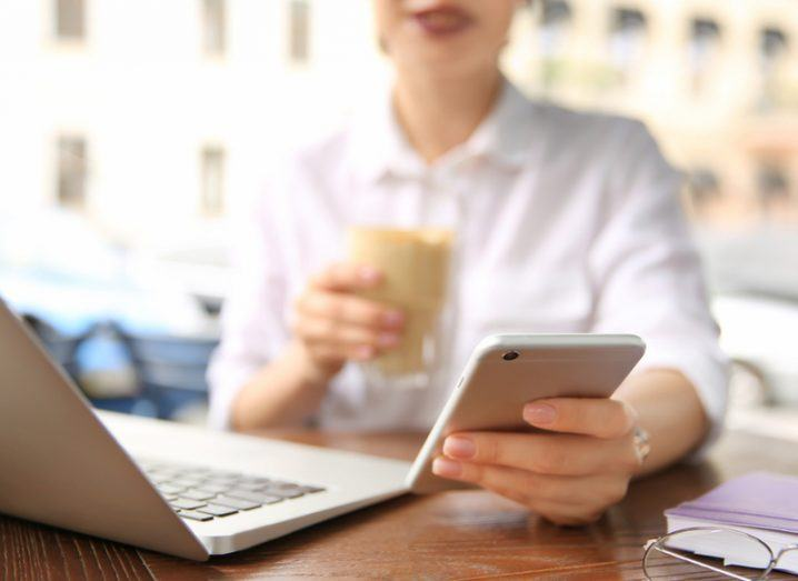 close up of a woman working remotely on a cafe terrace