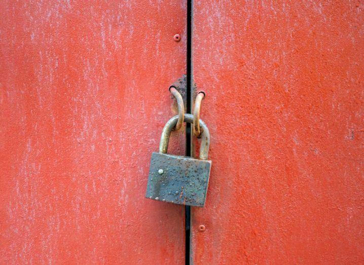 padlock on red door