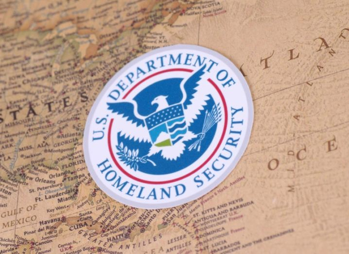 DHS symbol on a map of US
