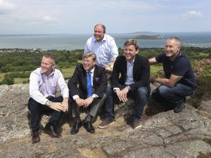 From left: Gavan Walsh, founder & CEO; Michael Tope, managing director; Niall O'Callaghan, technical Director and co-founder; Elmo the dog; Niall Prenty, business development director; and Bob Nixon, sales director and co-founder. Image: Conor McCabe