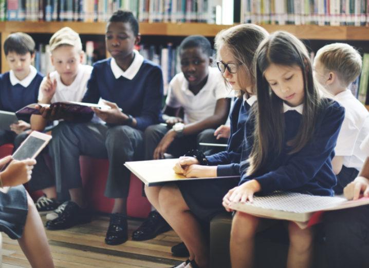 Children reading books in school education