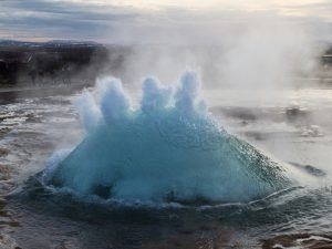 Volcanic gas bubble bursting in water