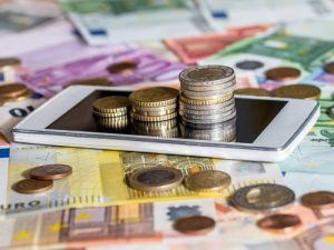 smartphone surrounded by cash