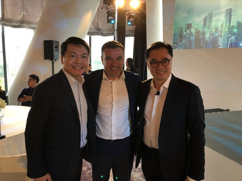 three men announcing a deal