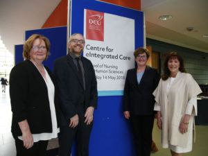 Three women and one man stand in front of a sign saying 'DCU Centre for eIntegrated Care'