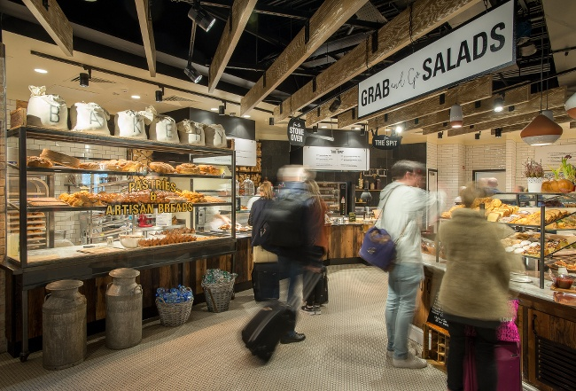 Airport visitors with suitcases visit the 'Grab & Go Salads' bar at the Marqette food hall, Dublin Airport