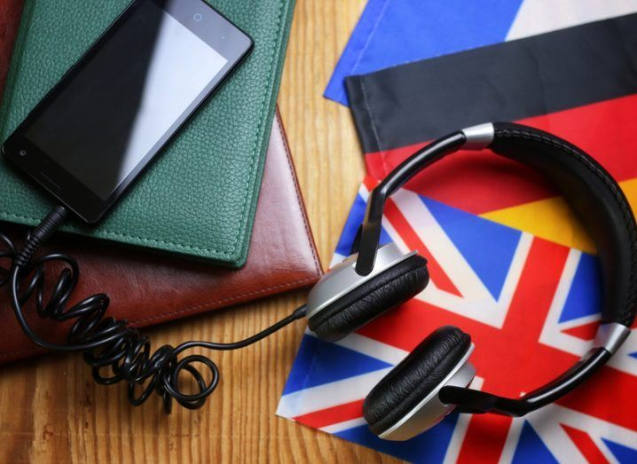headphones and a smartphone for learning languages