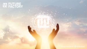 Hands backlit by a bright sun amid a cloudy sky reach up to grasp The Future Factory logo
