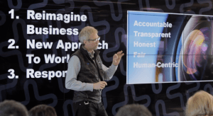 Paul Daugherty stands in front of a large presentation screen that reads: 'Accountable, Transparent, Honest, Fair, Human-Centric'