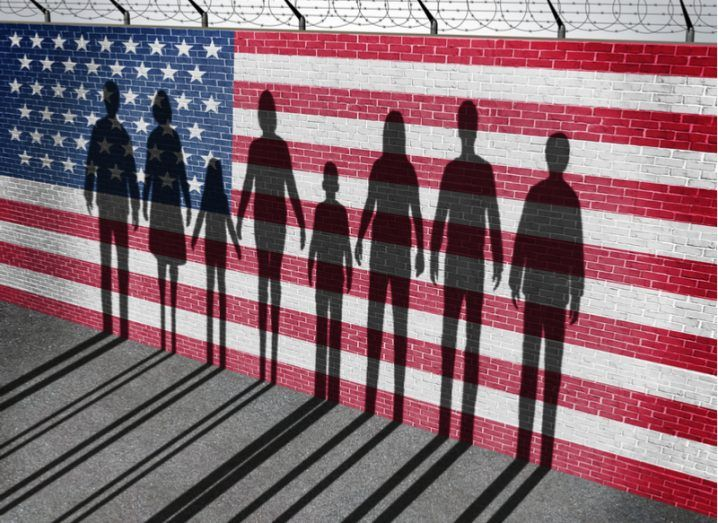 Image of family against a wall shaped like US flag with barbed wire atop
