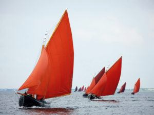 Traditional wooden Galway Hooker boats competing in a regatta. Image: Rihardzz/Shutterstock