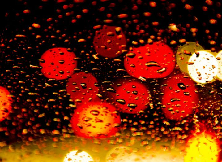 lights through a rain-spattered window