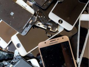 Pile of discard mobile phones which could be used in urban mining