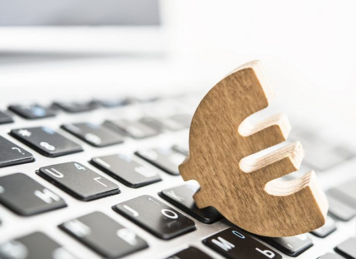 Image of a wooden euro symbol on a computer keyboard