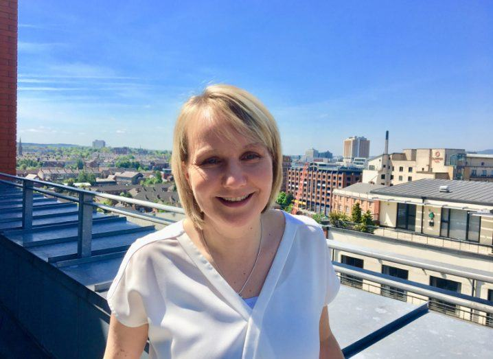 patricia meara on rooftop with blue sky in background