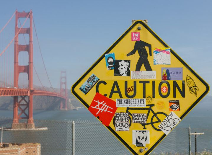 Golden Gate Bridge in background with Caution sign in foreground