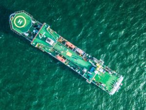 birds-eye view of a subsea cable installation boat on the water