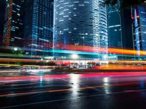 colourful light trails on modern city street