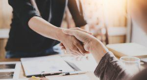 Handshake in business meeting, creating a good first impression.
