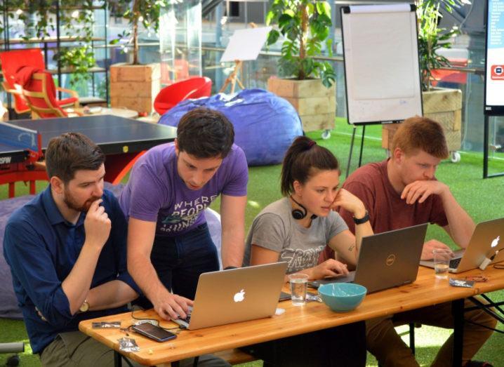 wia staff working on mac laptops