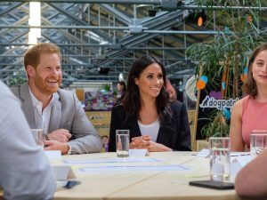 Prince Harry and Meghan Markle smile at the round table discussion in Dogpatch Labs